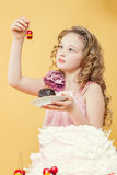 Adorable little girl posing with cake in studio Royalty Free Stock Photo