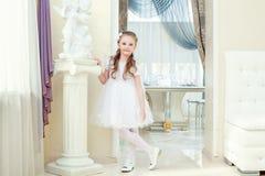 Adorable little girl posing in elegant dress Stock Photography