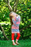 Adorable little girl posing in a park Stock Images