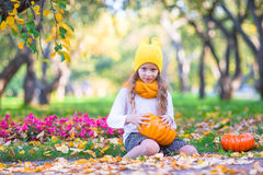 Adorable little girl with pumpkin outdoors  Royalty Free Stock Photography