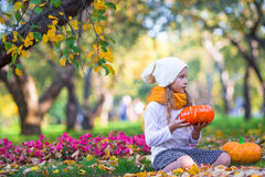 Adorable little girl with pumpkin outdoors at Stock Image