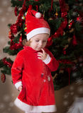 Adorable little girl putting wishes Royalty Free Stock Image