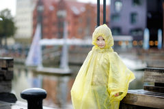 Adorable little girl in a rain coat Stock Photography
