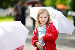 Adorable little girl at rainy day in autumn Royalty Free Stock Image