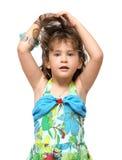 Adorable little girl raises her hair Stock Photo
