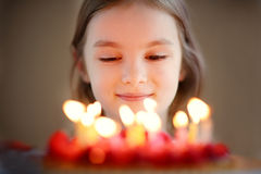 Adorable little girl and a raspberry cake Stock Image