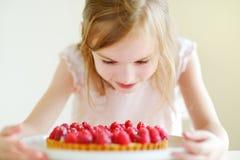 Adorable little girl and raspbrerry cake Stock Photography