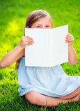 Adorable little girl reading book Royalty Free Stock Photos