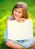 Adorable little girl reading book Royalty Free Stock Images