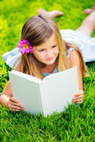 Adorable little girl reading book Stock Image