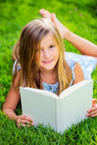 Adorable little girl reading book Stock Photography