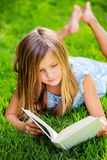 Adorable little girl reading book Stock Photos