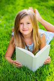 Adorable little girl reading book Royalty Free Stock Photography
