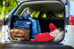 Adorable little girl ready to go on vacations with her parents Stock Photography