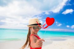 Adorable little girl with red heart in hands on Stock Images