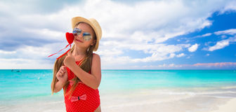 Adorable little girl with red heart in hands on Royalty Free Stock Photo
