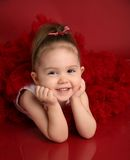 Adorable little girl in red pettiskirt tutu Royalty Free Stock Photo