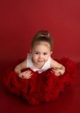 Adorable little girl in red pettiskirt tutu Stock Photo