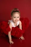 Adorable little girl in red pettiskirt tutu Royalty Free Stock Image