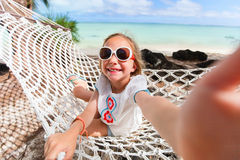 Adorable little girl relaxing in hammock Royalty Free Stock Images