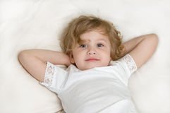Adorable little girl resting in the bed. Close-up Stock Image