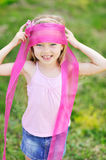 Adorable little girl with a ribbon Royalty Free Stock Photo
