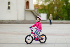 Adorable little girl riding a bike Royalty Free Stock Images
