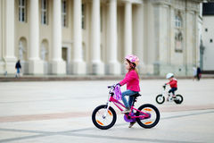 Adorable little girl riding a bike Royalty Free Stock Image