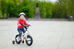 Adorable little girl riding a bike Royalty Free Stock Photo