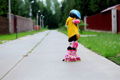 Adorable little girl on roller skates Royalty Free Stock Image