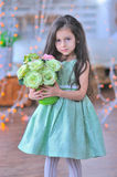Adorable little girl with roses Royalty Free Stock Photos
