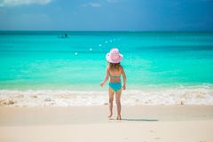 Adorable little girl runing in shallow water at Stock Images