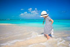 Adorable little girl runing in shallow water at Royalty Free Stock Photos