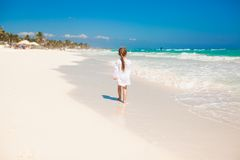 Adorable little girl running on exotic white beach Stock Photography