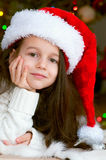 Adorable little girl in santa hat Stock Photo