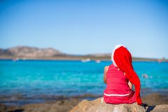 Adorable little girl in Santa hat and red dress Stock Images