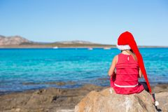 Adorable little girl in Santa hat and red dress Stock Photo