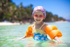 Adorable little girl in the sea have fun Stock Image
