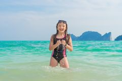 The young girl playing with water. Freedom and travel concept stock photos