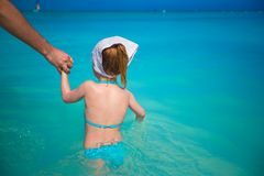 Adorable little girl in the sea on tropical beach Royalty Free Stock Photography
