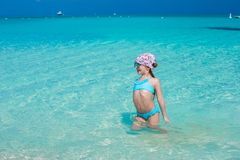 Adorable little girl in the sea on tropical beach Stock Image