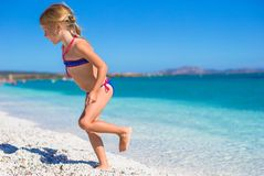 Adorable little girl in shallow water have fun at Royalty Free Stock Photos