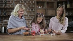 Adorable little girl sharing homemade cookies stock footage