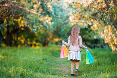 Adorable little girl with shopping bags outdoors Royalty Free Stock Photography