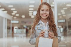 Adorable little girl at the shopping mall stock photo