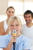 Adorable little girl singing with a microphone Royalty Free Stock Photography