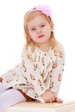 Adorable little girl sitting on the banquette Royalty Free Stock Photography