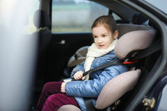 Adorable little girl sitting in a car seat Royalty Free Stock Photography
