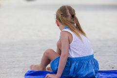 Adorable little girl sitting on chair at tropical Royalty Free Stock Images