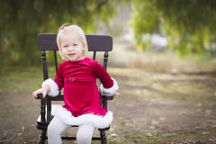 Adorable Little Girl Sitting in Her Chair Outside Stock Photo